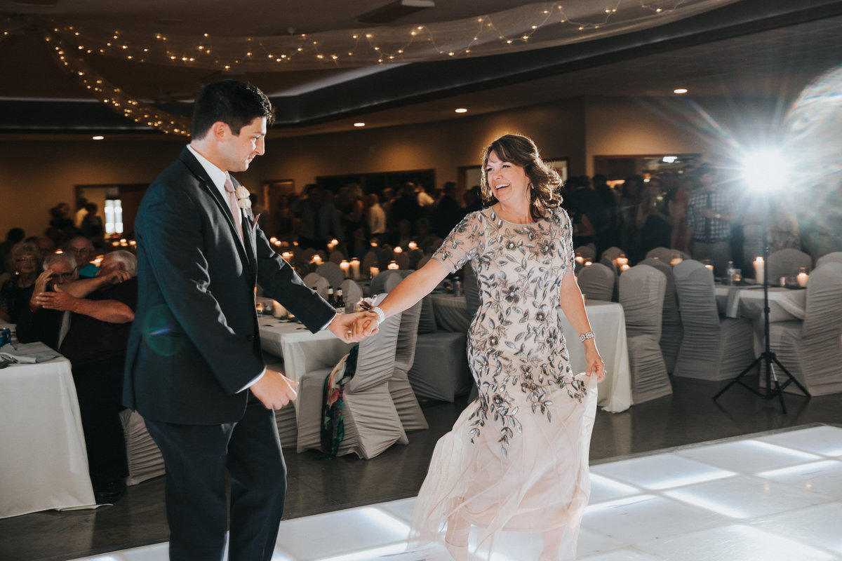 Mother and son dance in New Hampton IA wedding