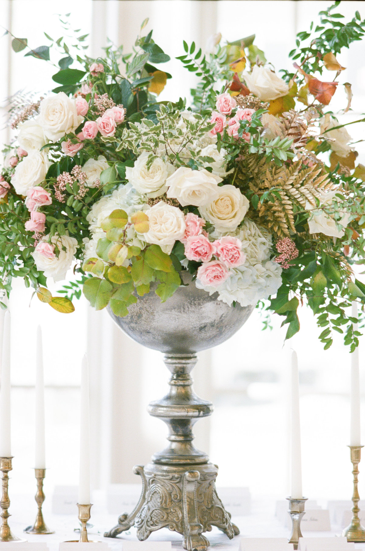 Tall floral arrangement on wedding reception table