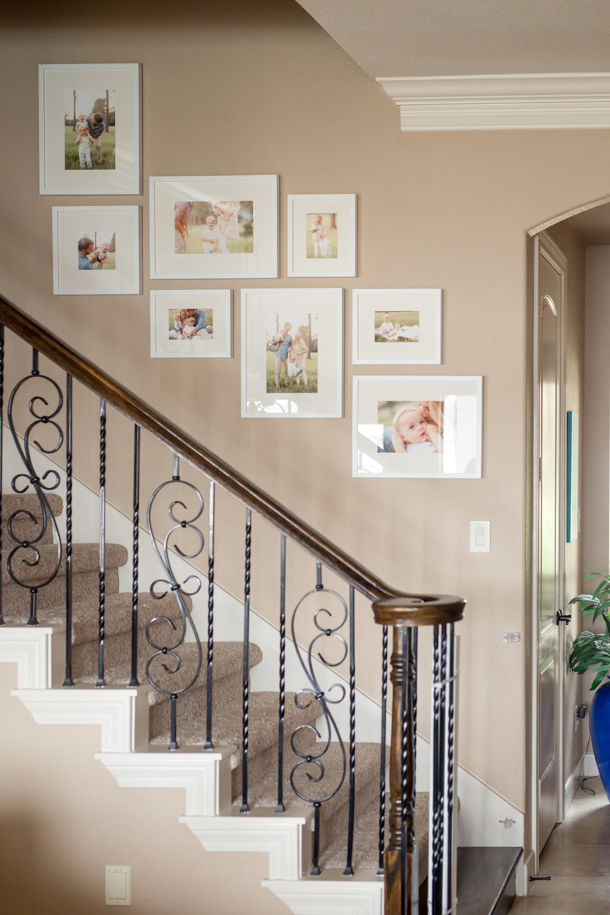 gallery of family pictures on stairs