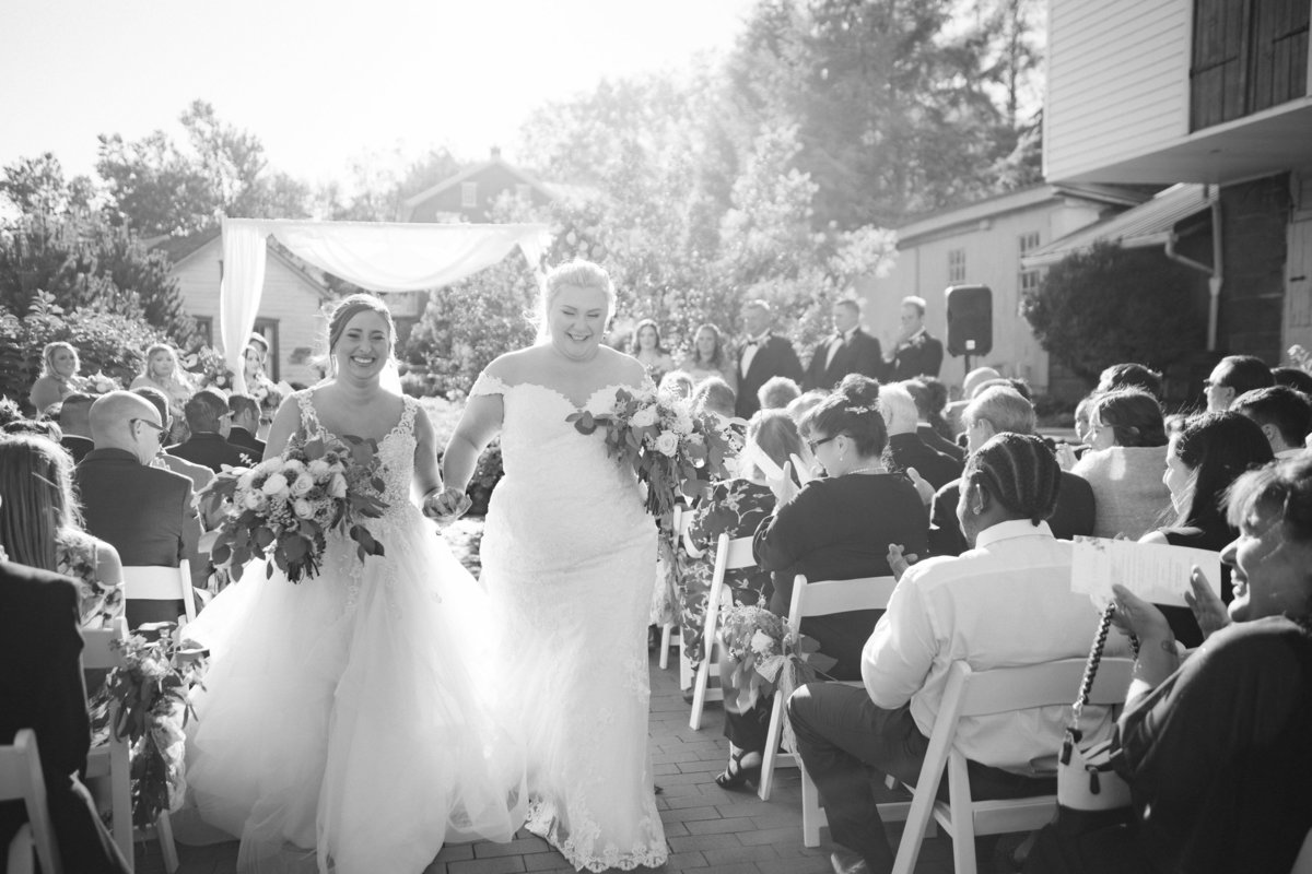 two brides walking up the aisle