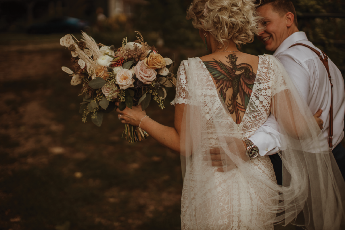 bride-and-groom-with-flowers@2x