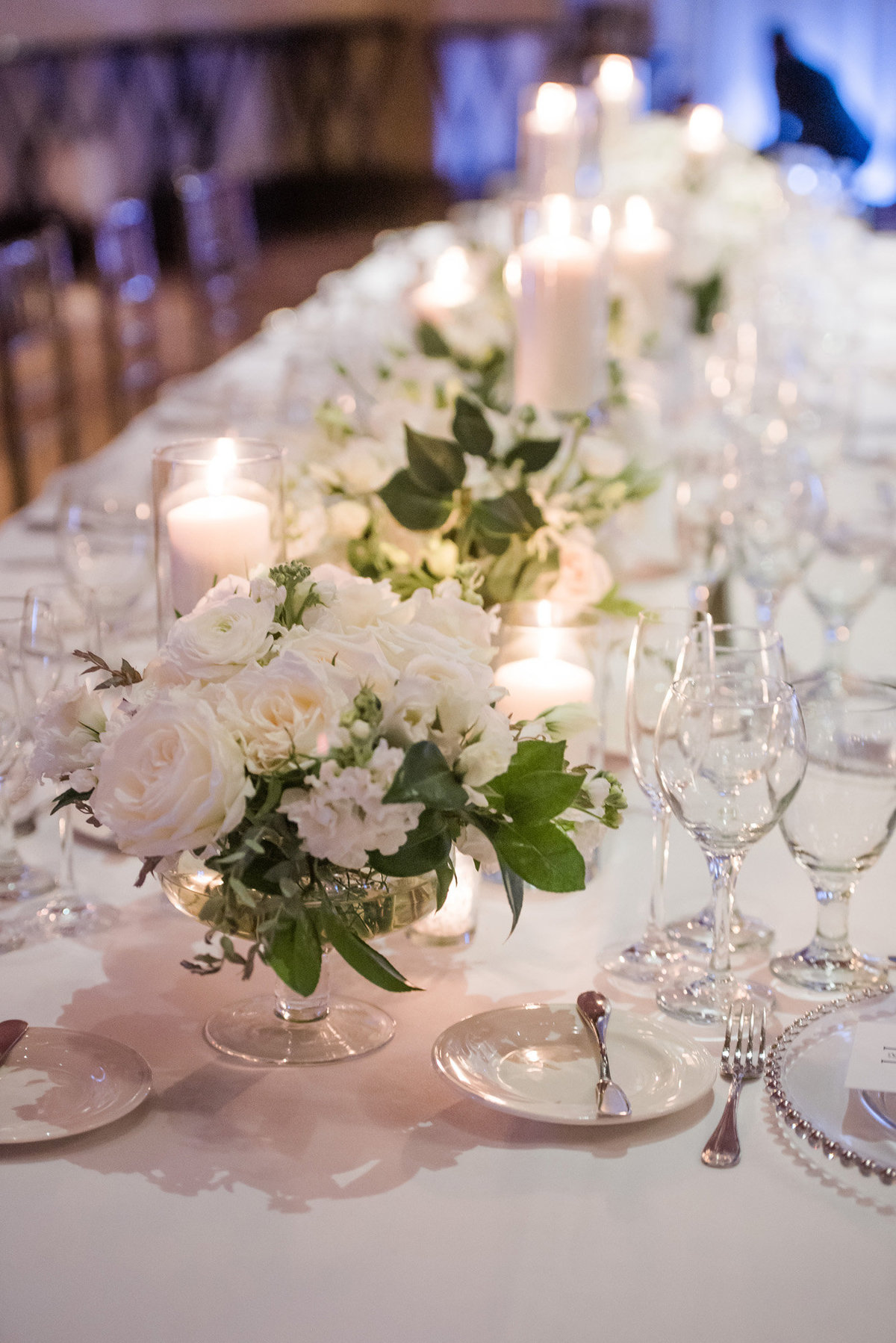 a wedding tablescape photo with white florals and greenery and white candles in JW Marriott Resort and Spa Las Vegas