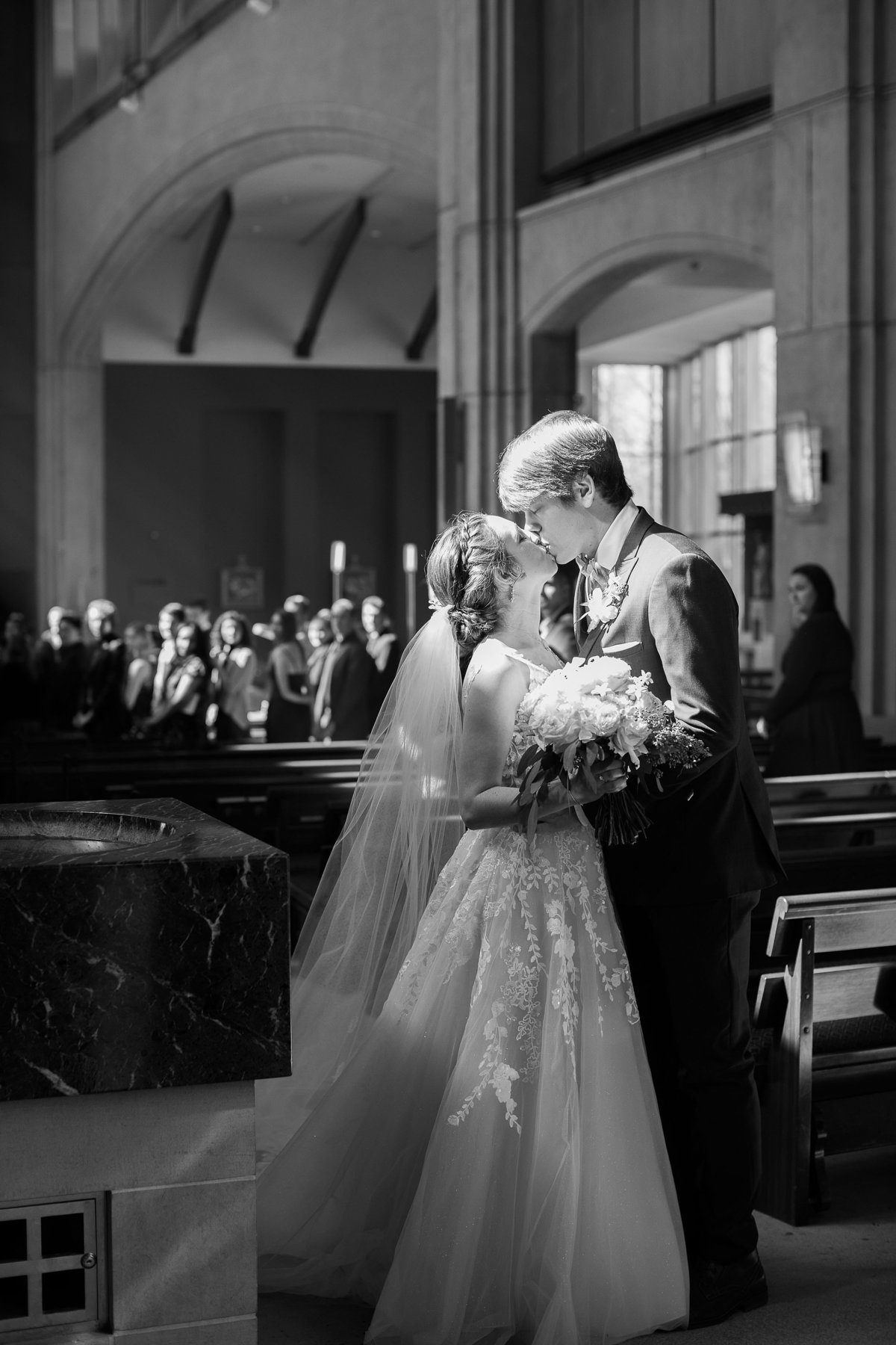 Wedding Photographer, black and white image of couple kissing
