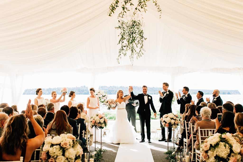 A luxury tent wedding on the water designed by Flora Nova Design Seattle