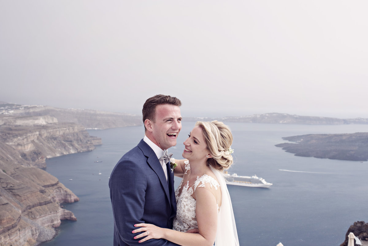 When you make each other laugh. A Bride and Groom during their destination wedding in Santorini Greece