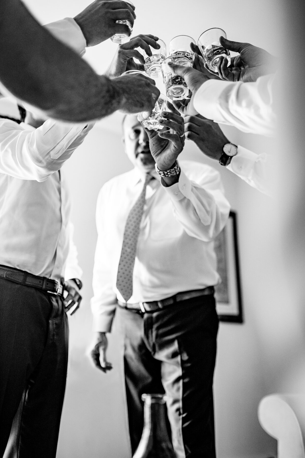 groom-getting-ready-toast-vermont-wedding-photographer-andy-madea-photographer