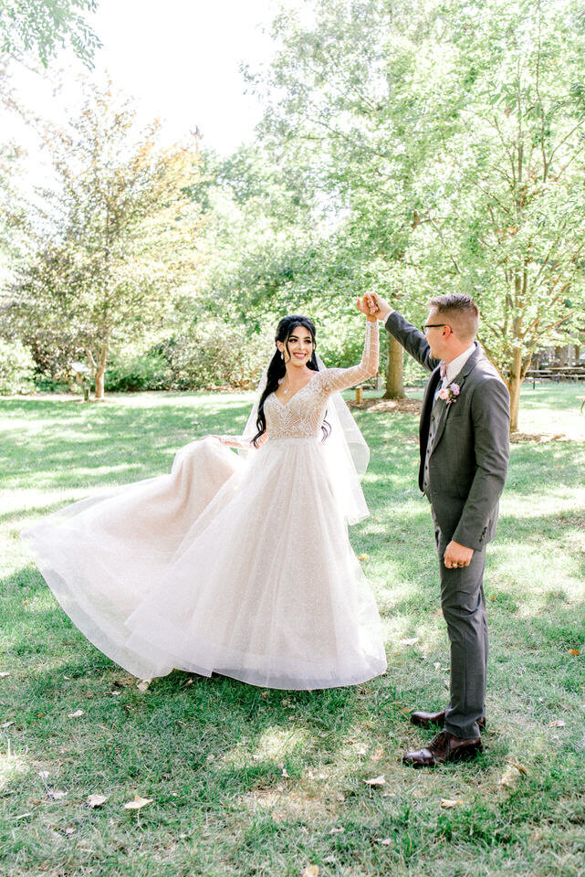 groom triwls his bride on east campus at UNL