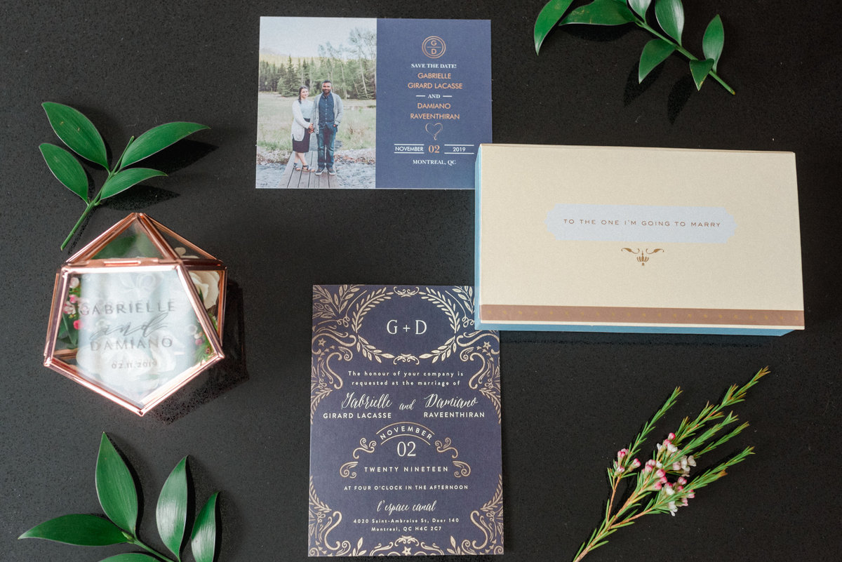 navy, black and gold details on save the dates, and invitations with greenery