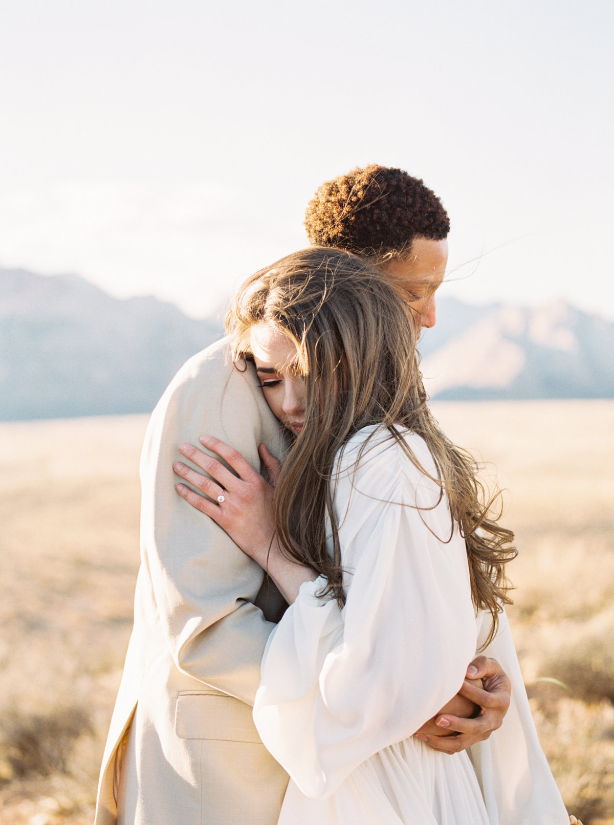 Couple embrace in the cold Las Vegas Desert for a photo session