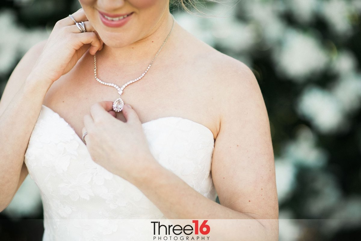 Bride showing off her beautiful necklace