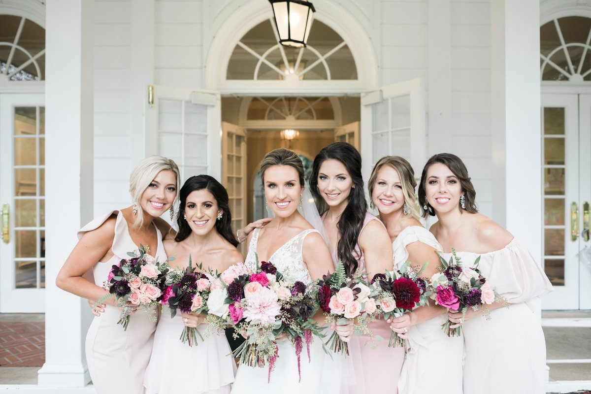 Wedding party in blush bridesmaid dresses