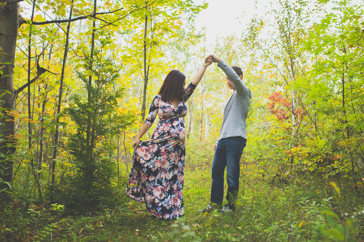 pregnant couple dancing in lush forest {Oakville Maternity Photographer}