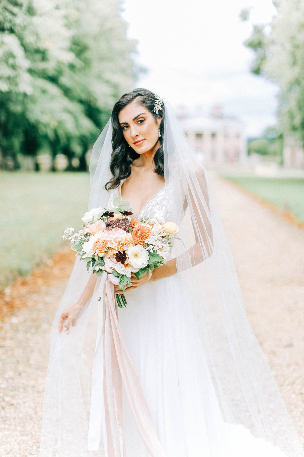 Romantic Bridal Gown with Peach and Ivory Bridal Bouquet