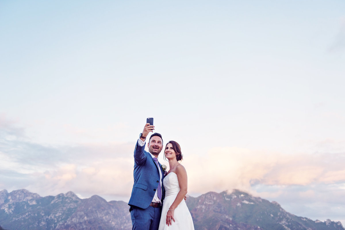 A Bride and Groom on the rooftop overlooking Ravello in Italy on a Destination Wedding