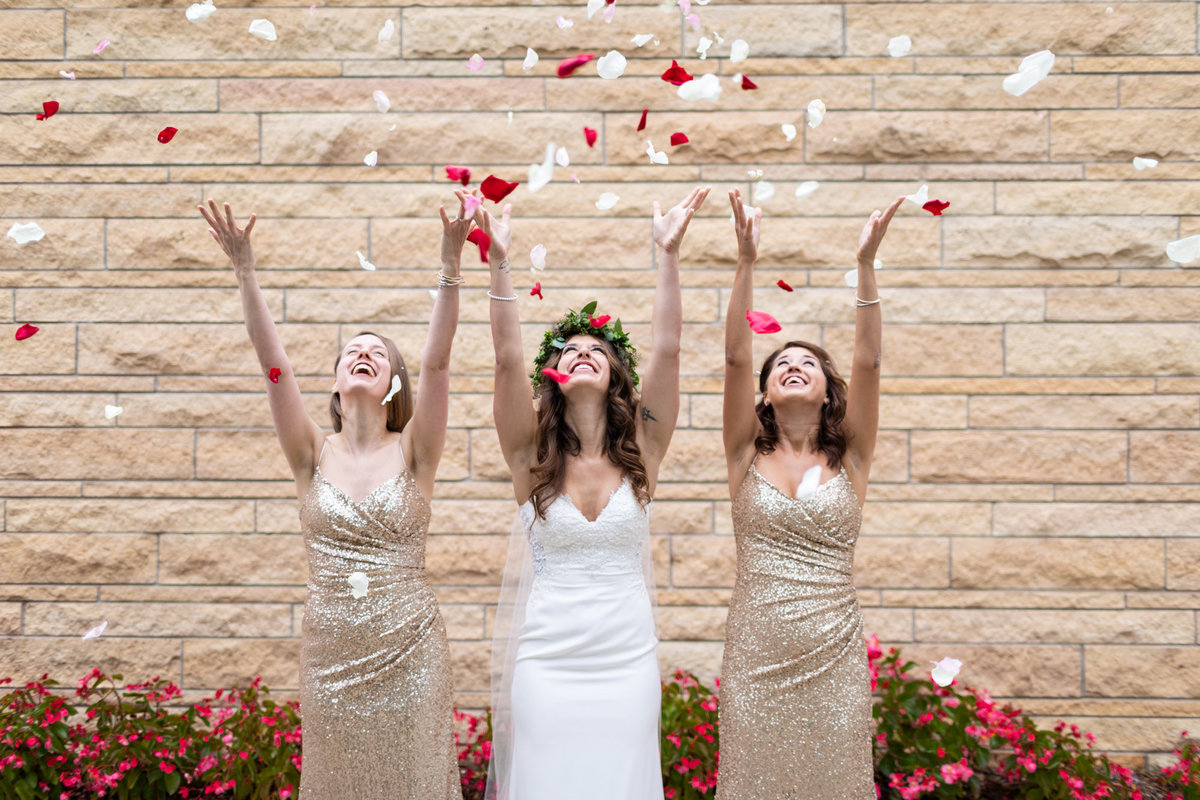Creative wedding photograph with the Bride and her sister Bridesmaids