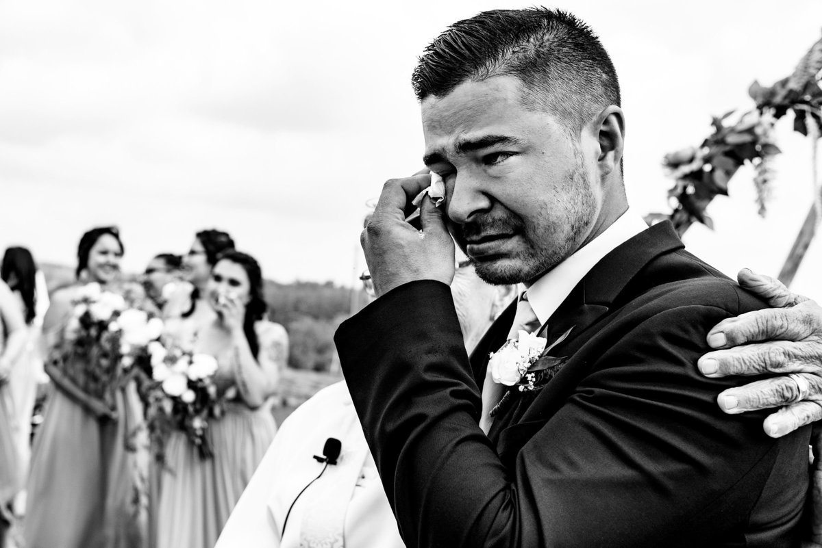Groom crying at wedding ceremony