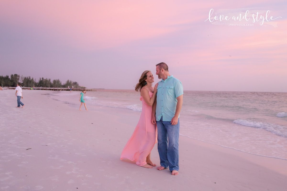 Bradenton Engagement Photography on Coquina Beach with couple posing at sunset