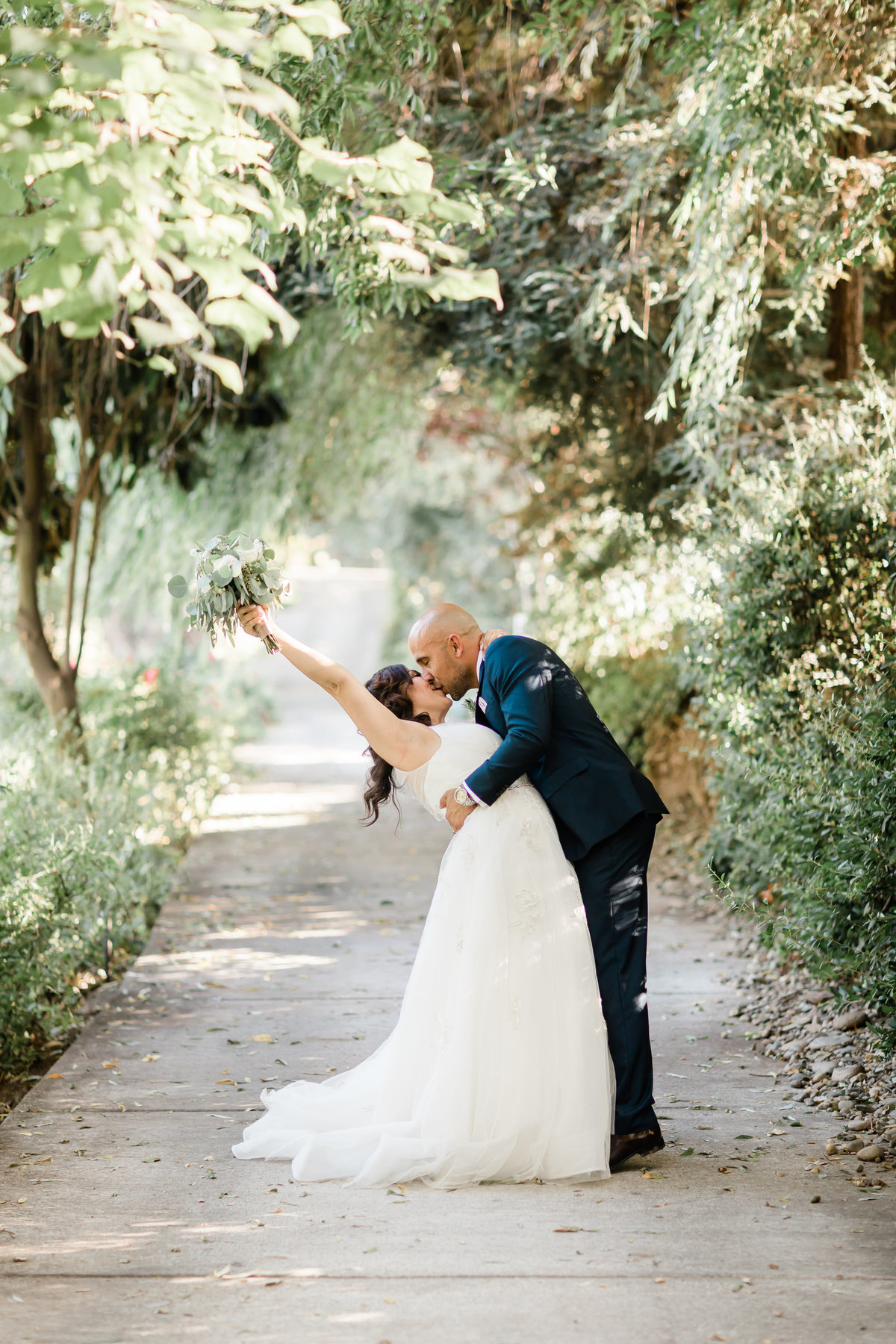 Claudia and Aldofo had their wedding in a garden paradise with trees and pathways.