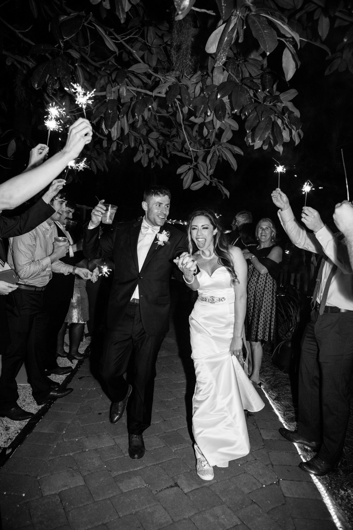 new husband and wife walking through sparkler exit in savannah