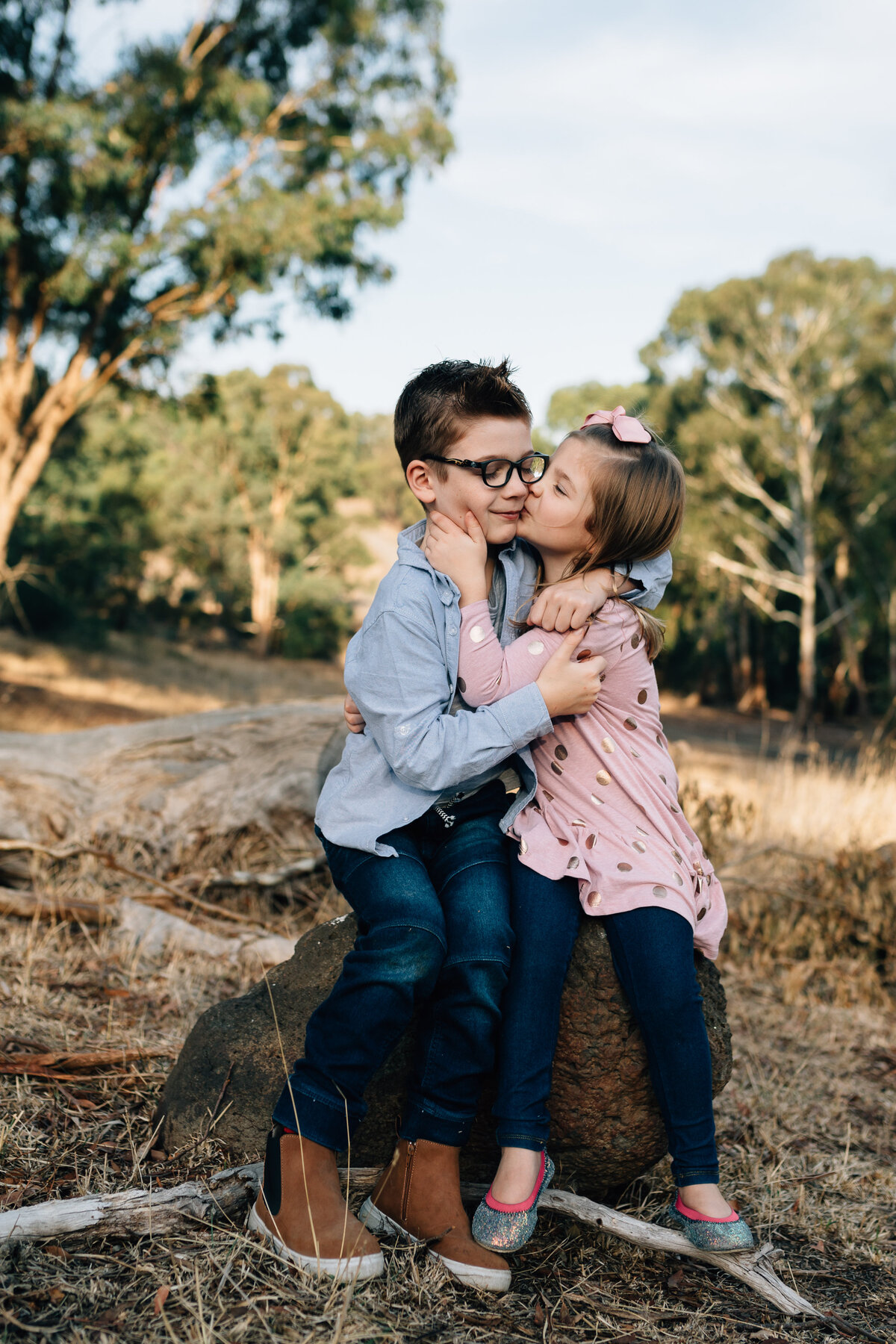 brother and sister hugging outside Melbourne family photography And So I Don't Forget Photography