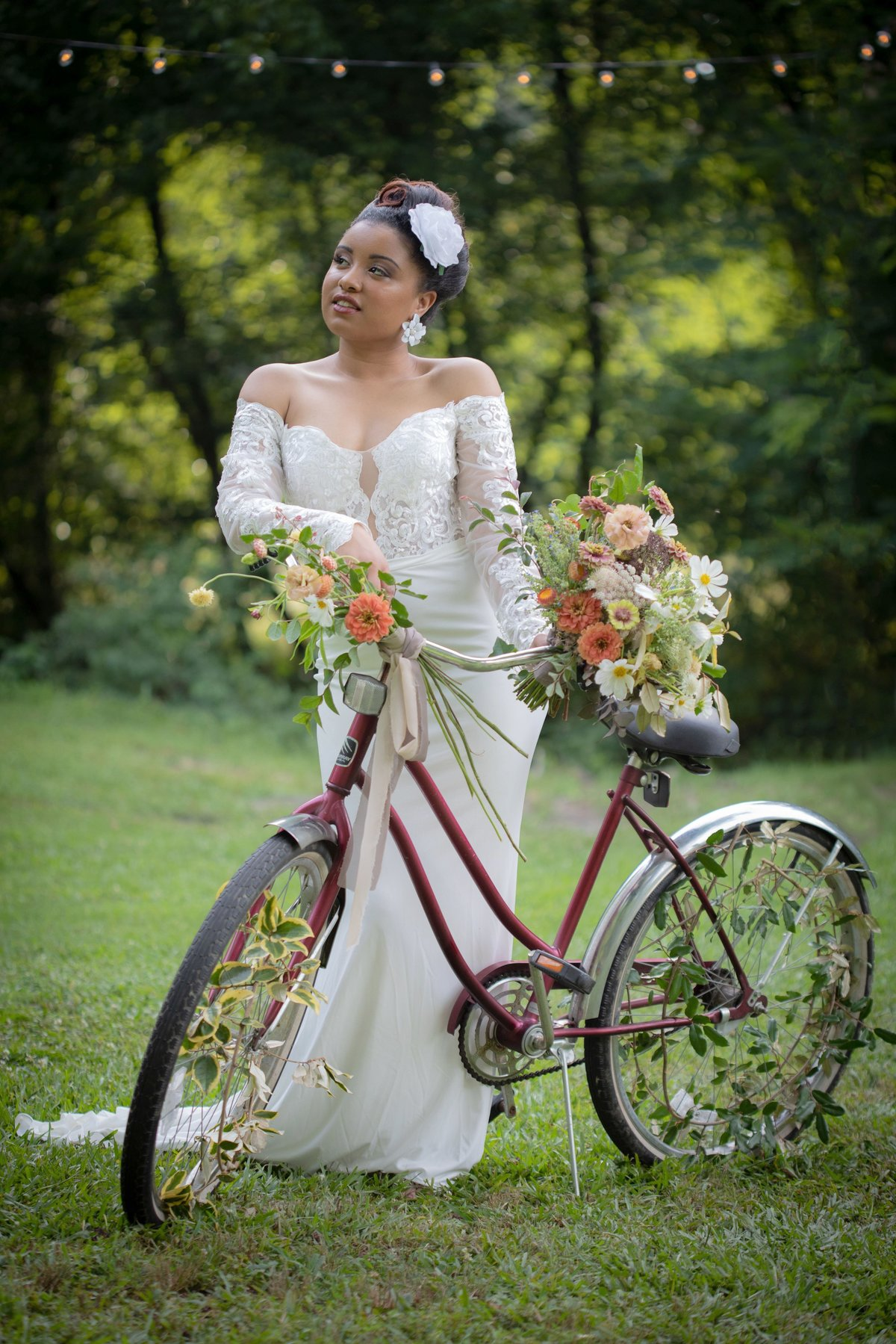 Bride posing with vintage bicycle