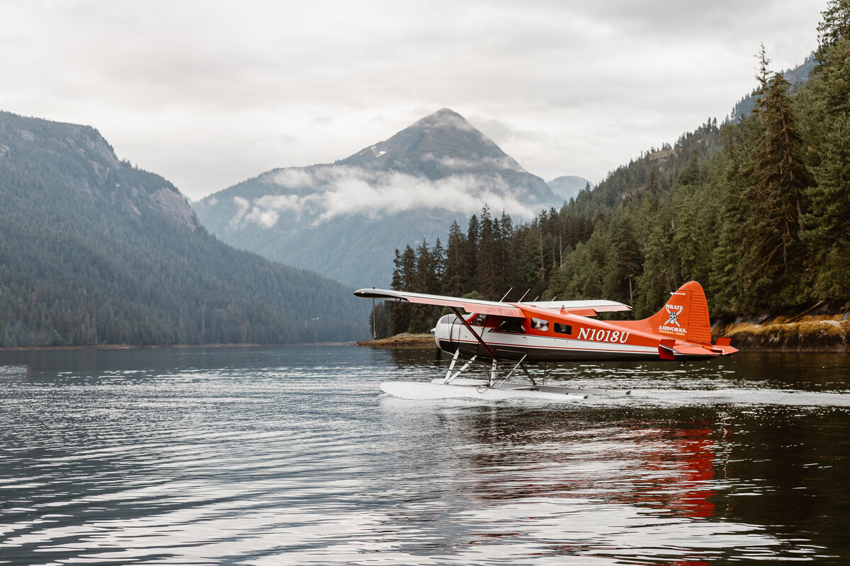 plane on the water in the mountains