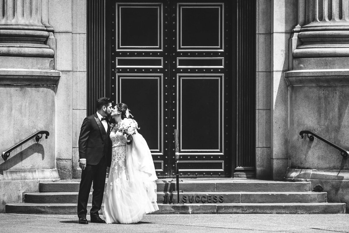 Bride and Groom kissing outside M&T Bank building in Buffalo, New York