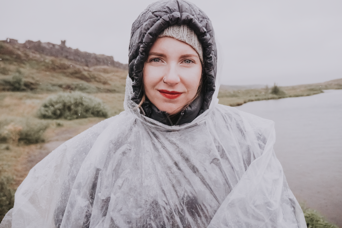 Portrait of woman wearing rain cover standing in Iceland
