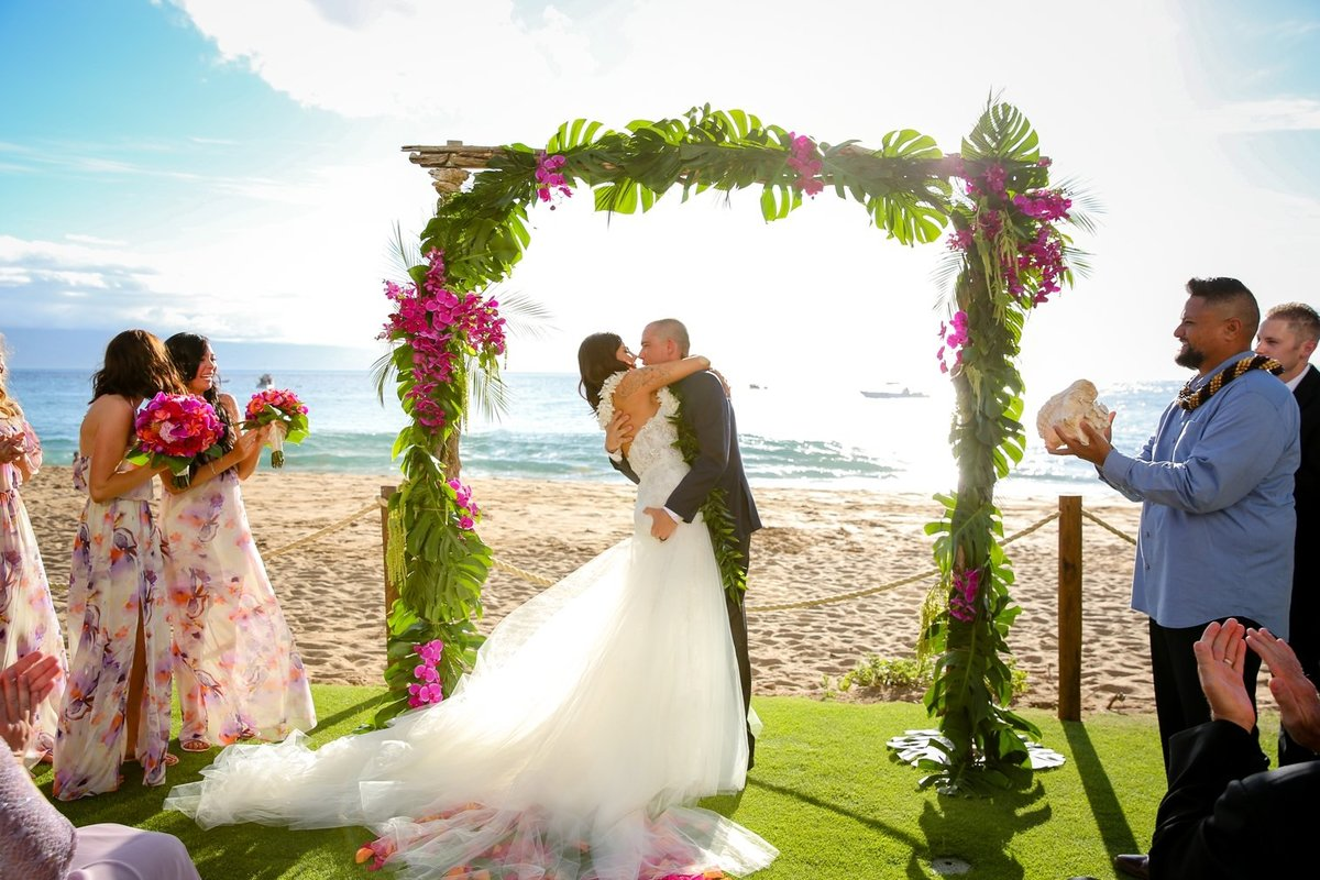 Maui Wedding Photography at The Westin Maui Resort and Spa with bride and groom kissing at the end of the ceremony