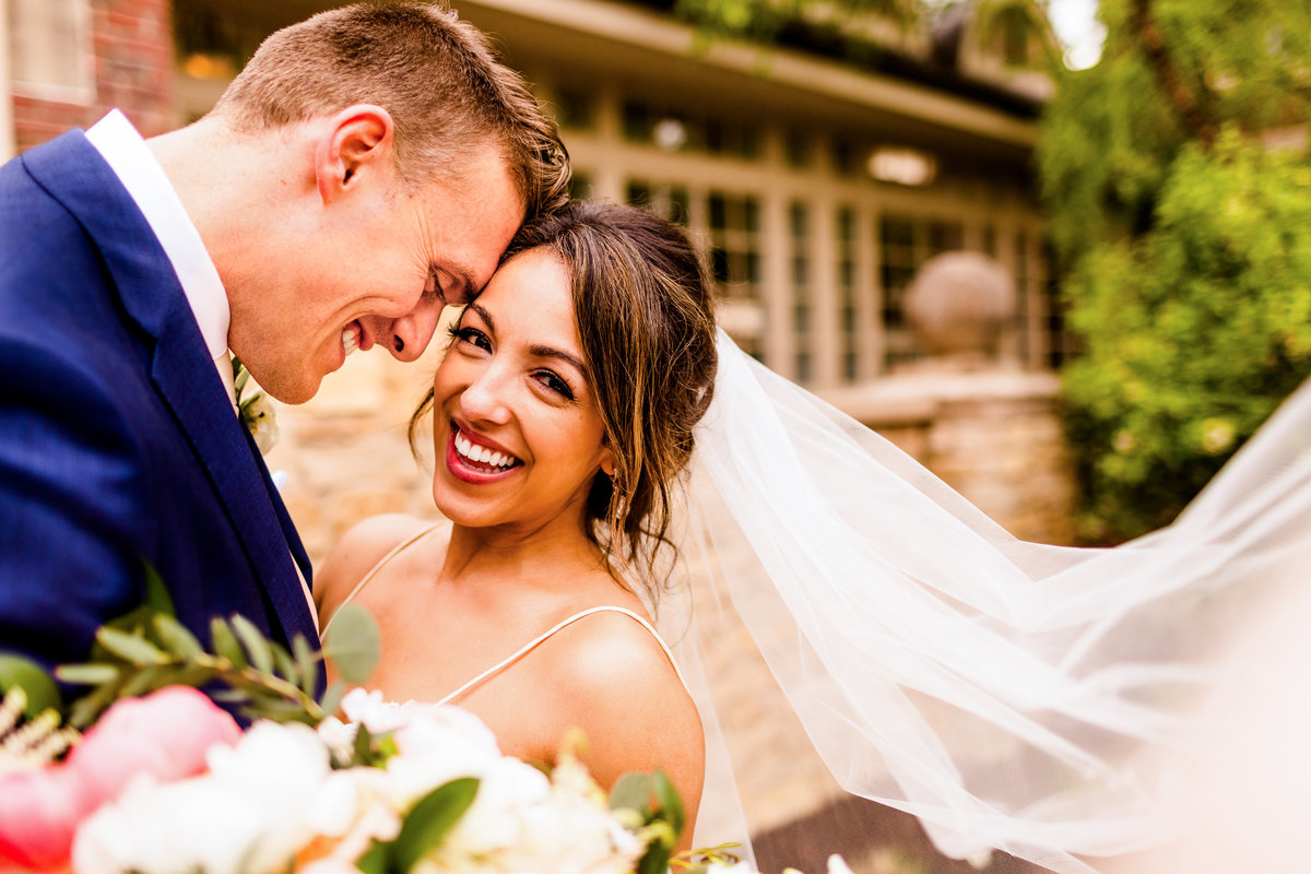 Bride and groom laughing at stonebridge country club aurora il