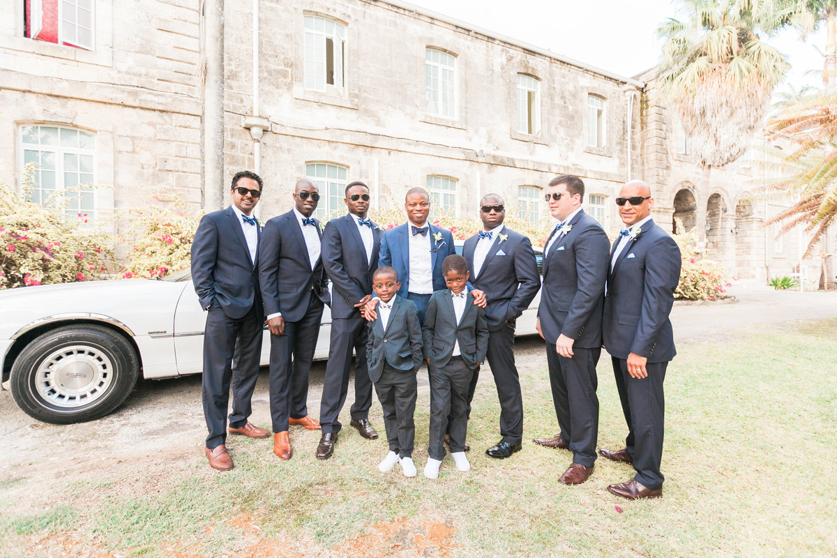 Groomsmen posing before destination wedding ceremony at Codrington College in Barbados