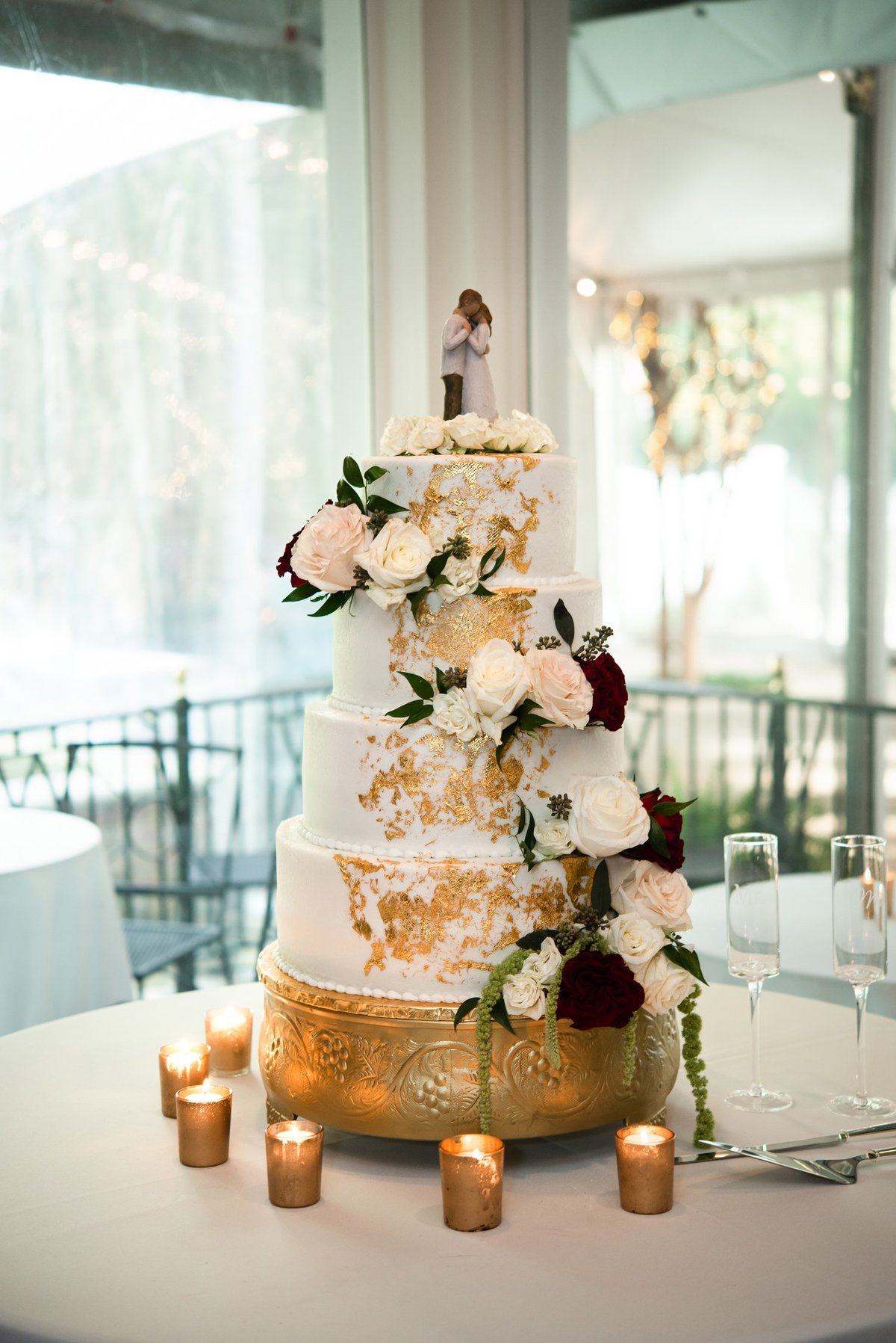 gold and maroon wedding cake
