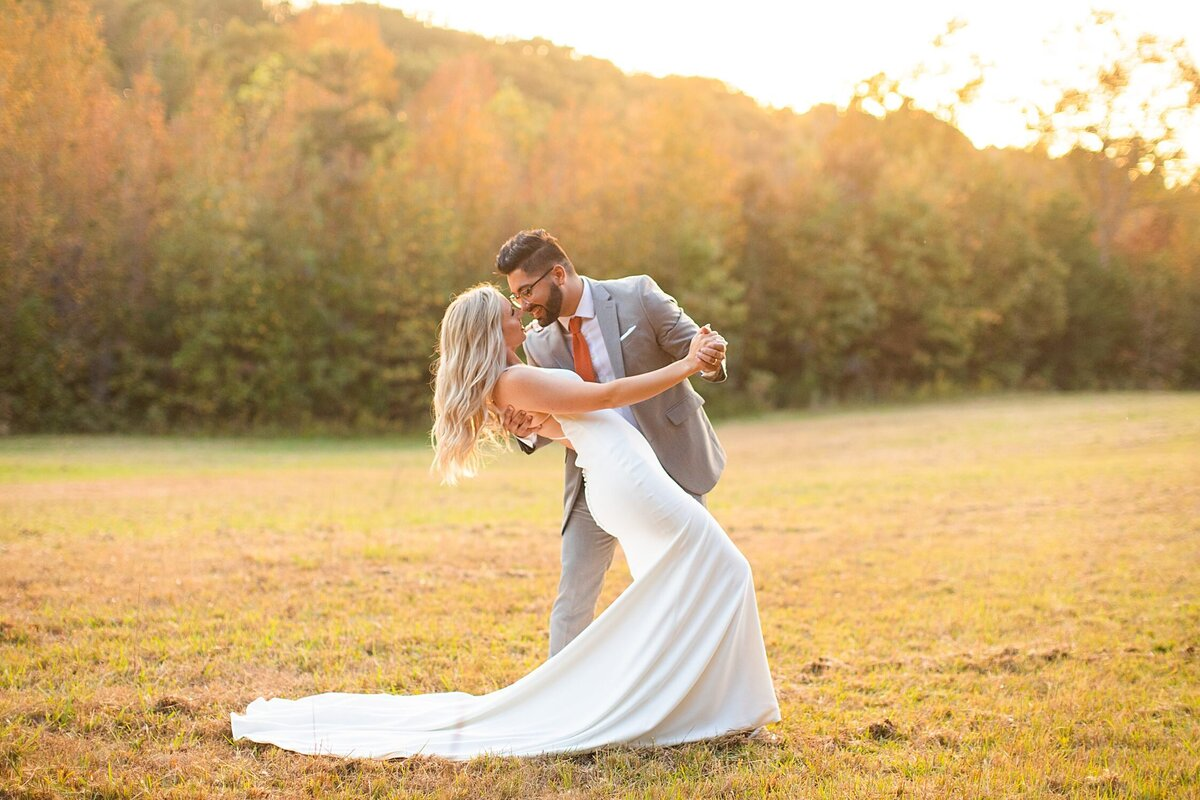 Greenville  Wedding Photographer, couple dancing in a field
