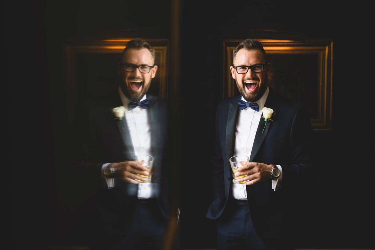 Groom with whisky laughin