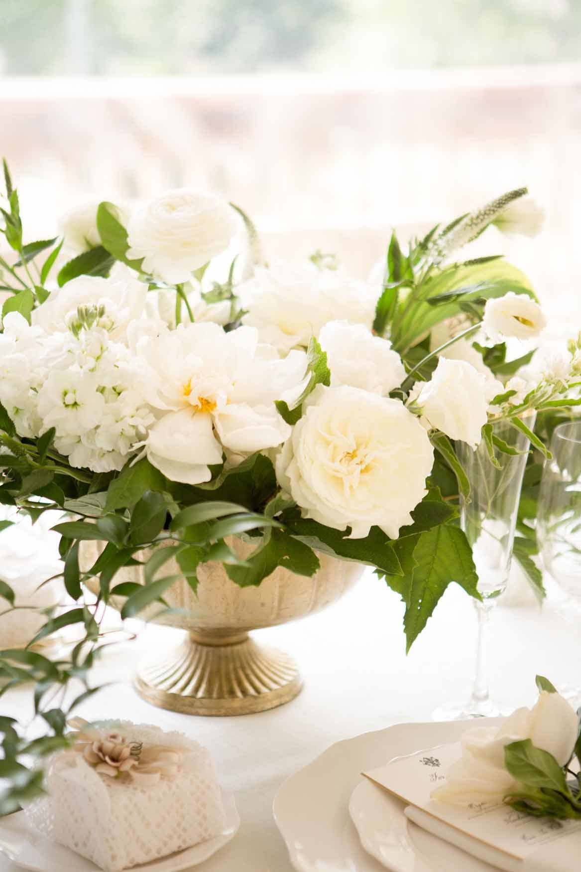 Gold compote wedding centerpiece with white peony's and garden roses