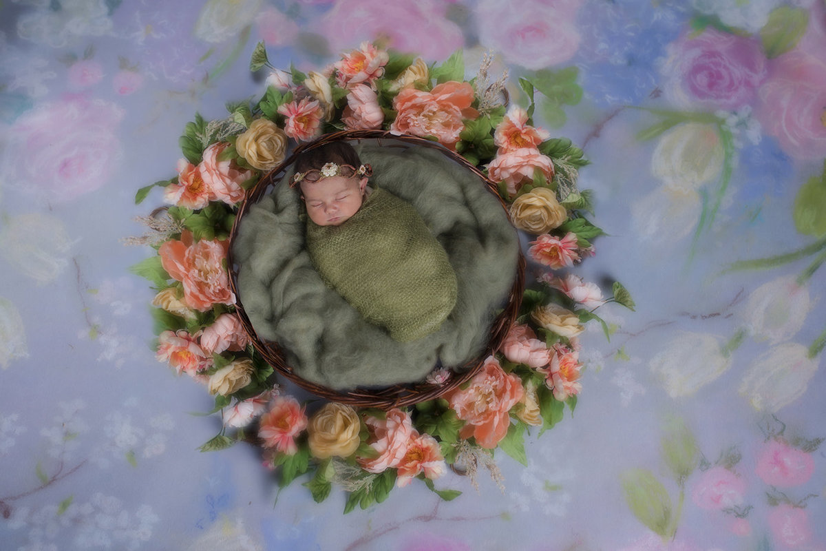 floral basket with newborn baby