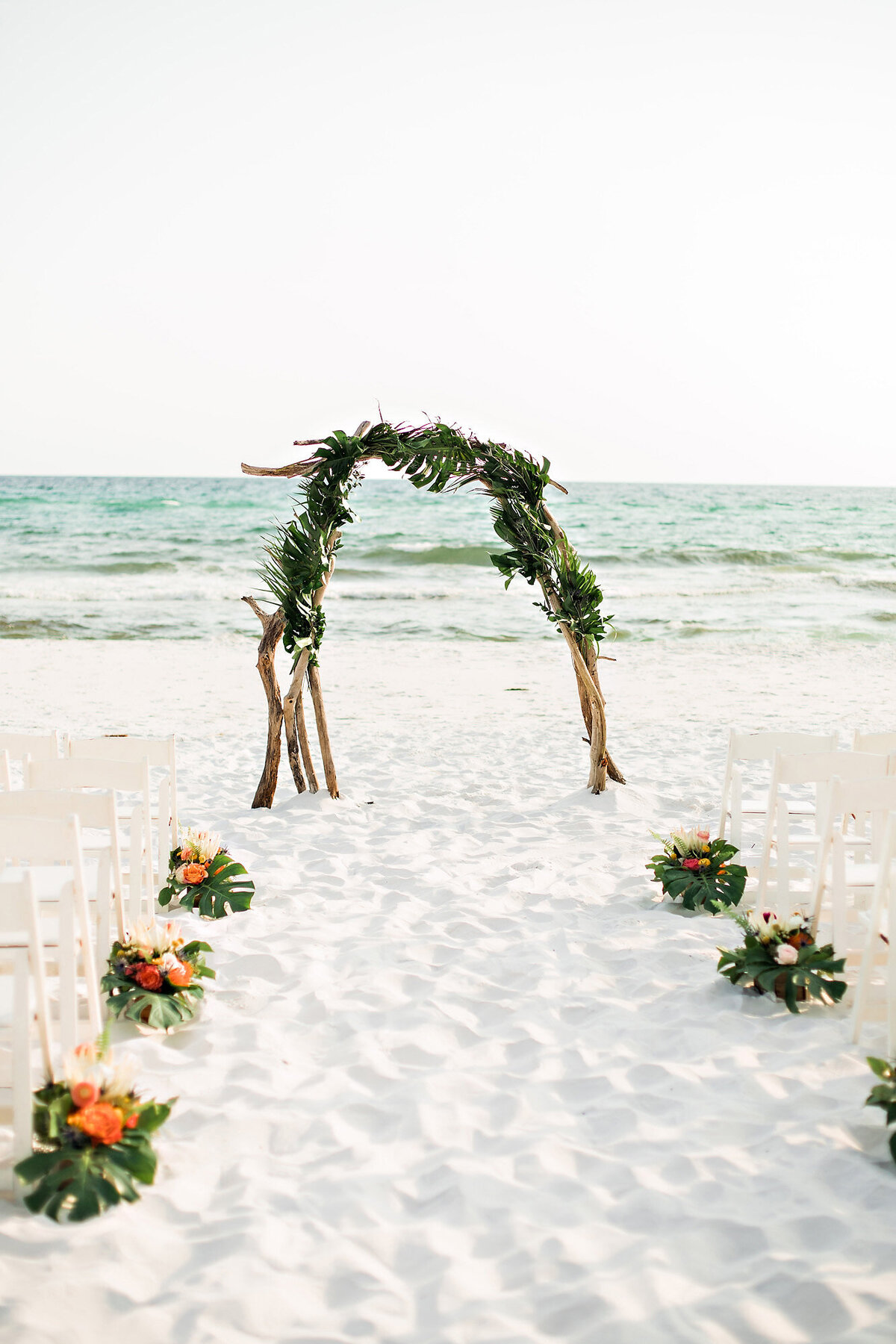 Tropical wedding altar setting on 30a carillon beach