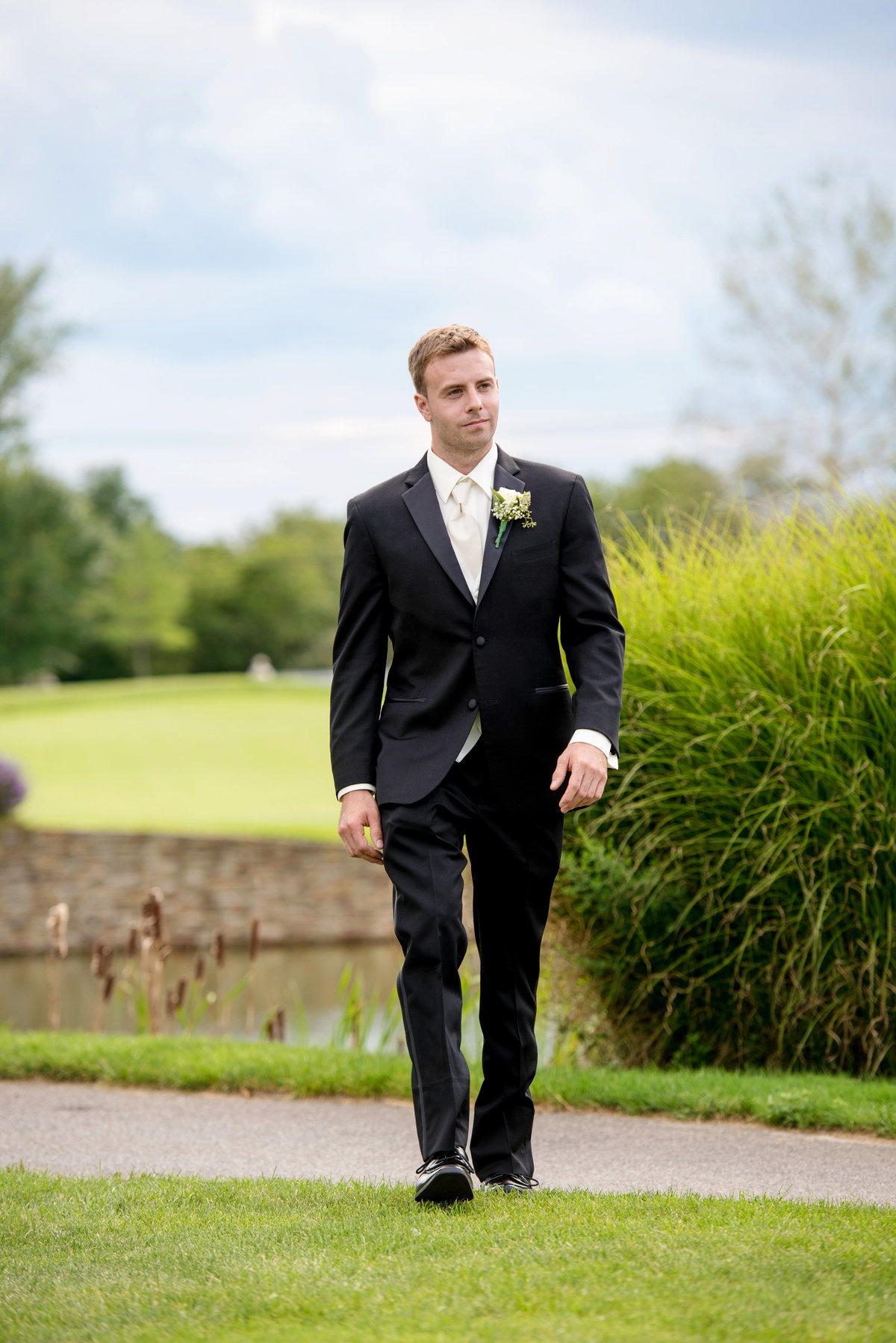groom walking on the golf course at Willow Creek Golf and Country Club