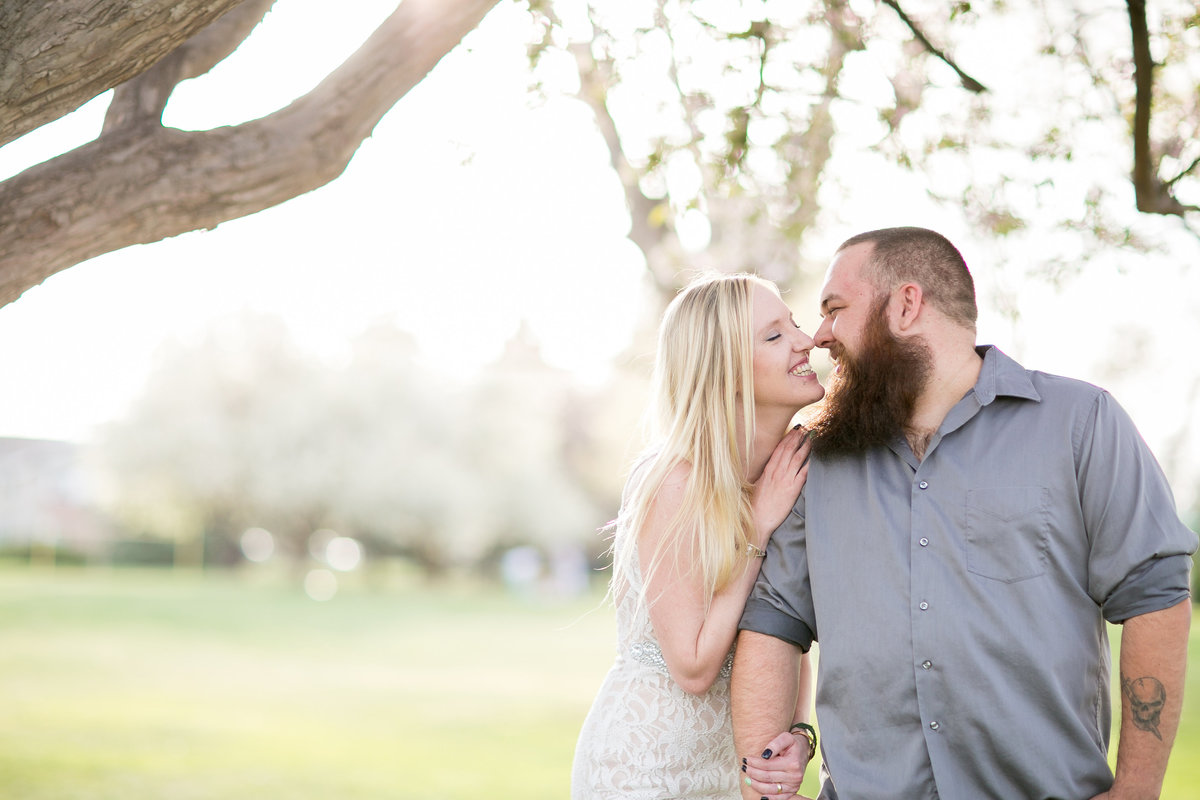 Couple smiling and giving eskimo kisses during their longmont engagement photos
