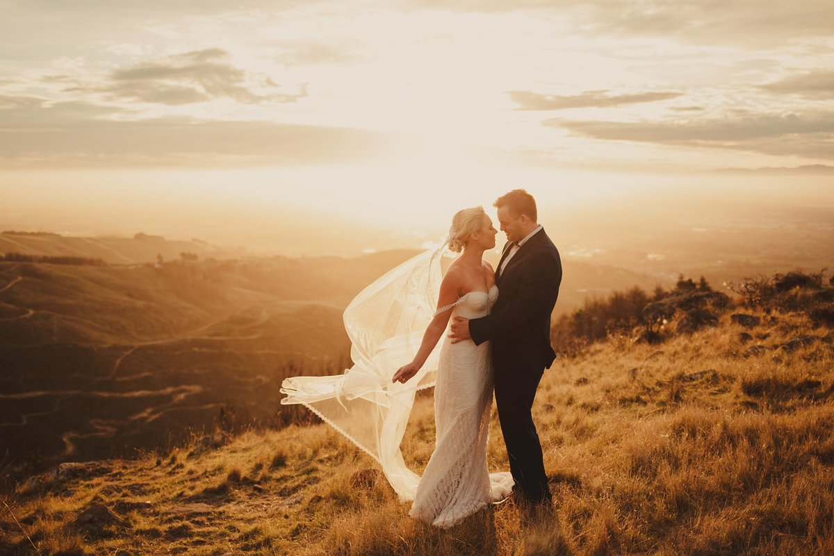 Bride and Groom in the golden sunset on Port Hills