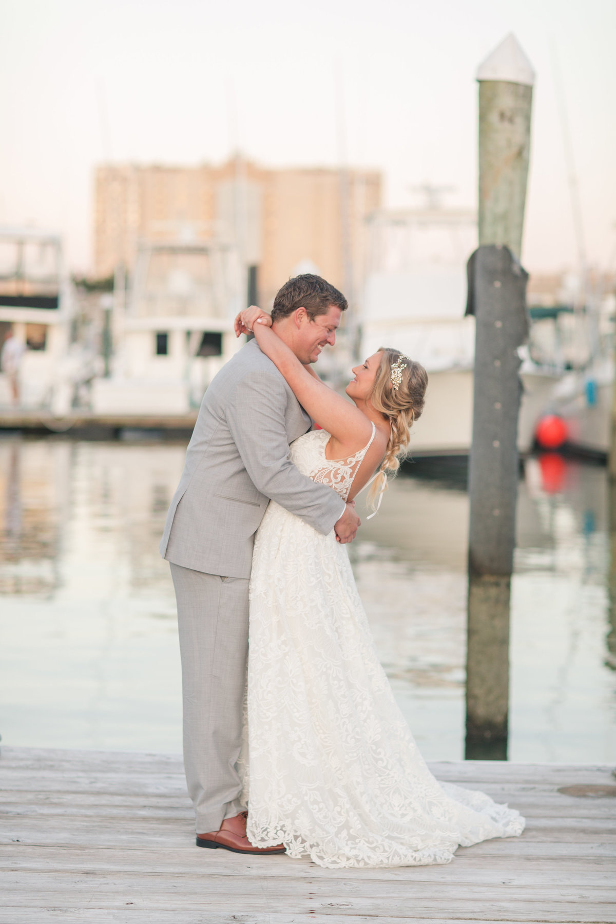 Bride and groom on the dock at The Water Table