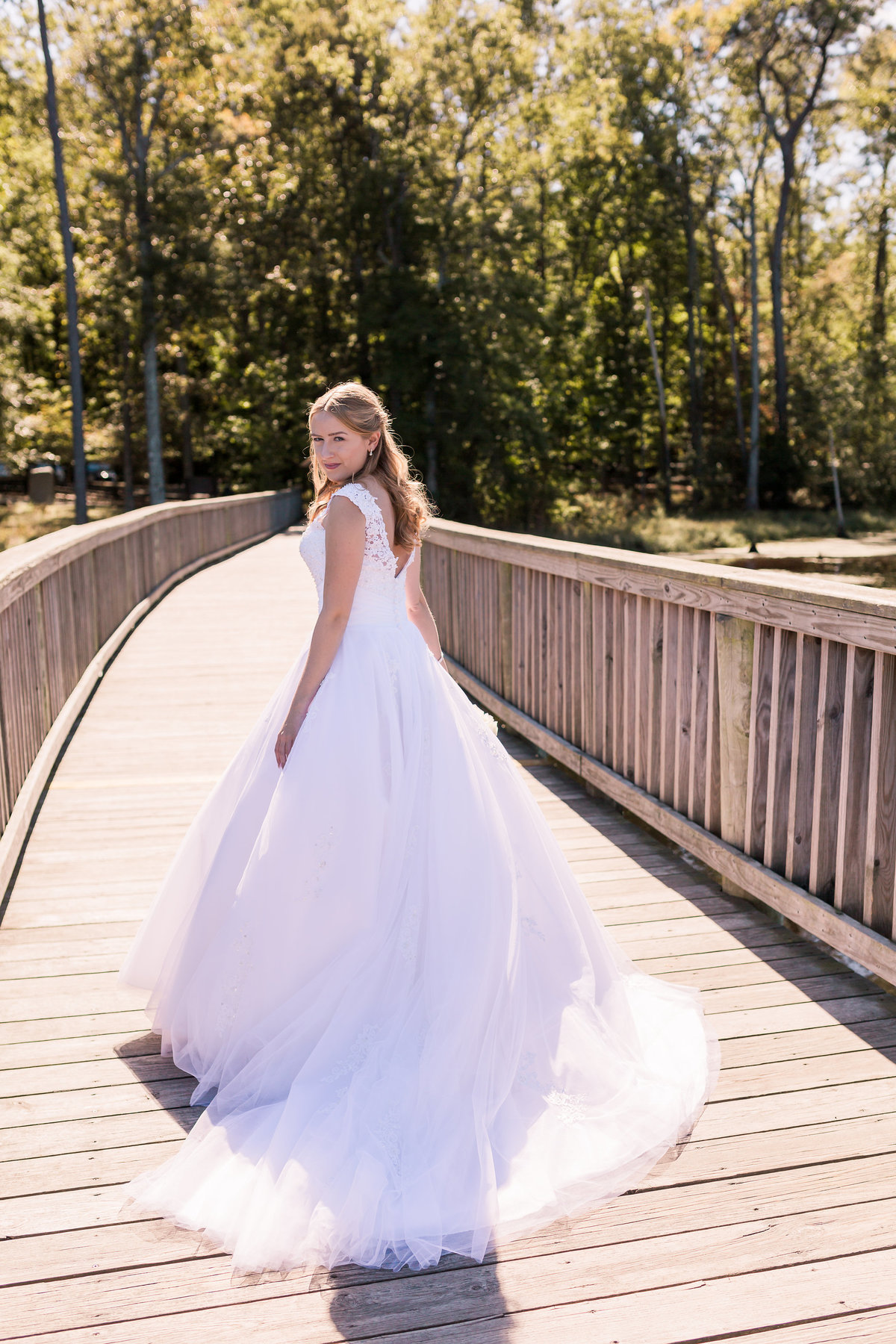 A bride in her dress at Newport News Park