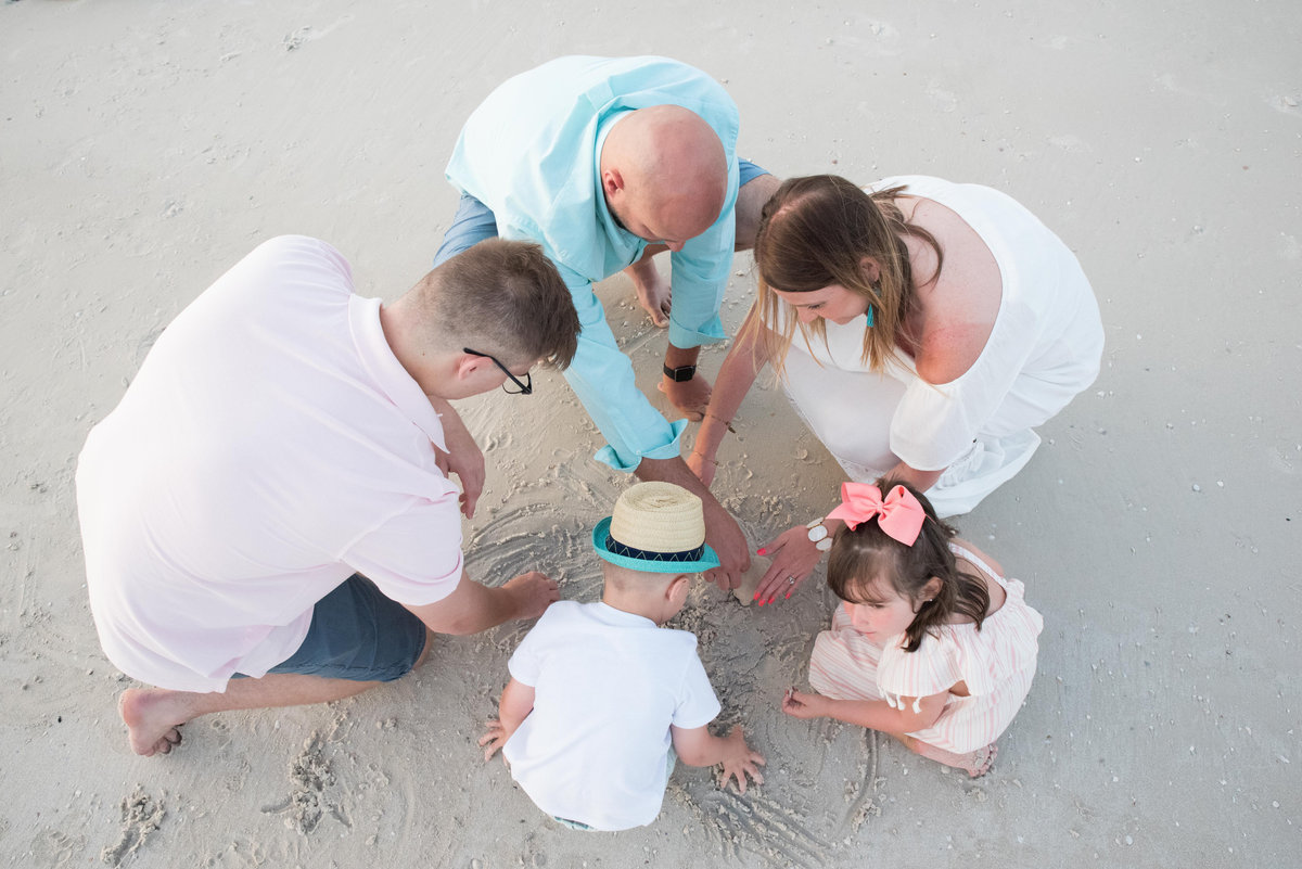 family playing in the sand at Honeymoon Island Beach