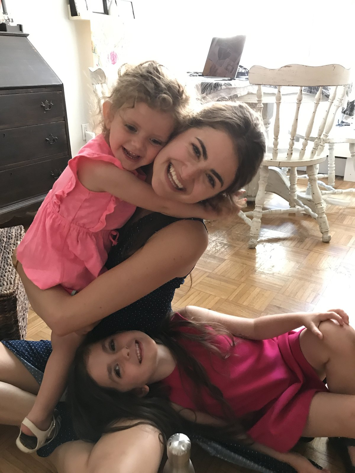 Laura Volpacchio hugs her client's children at her NYC studio.