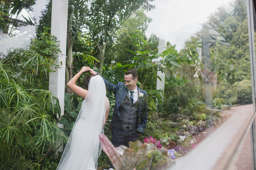 Bride and Groom in Greenhouse at Torquay Wedding