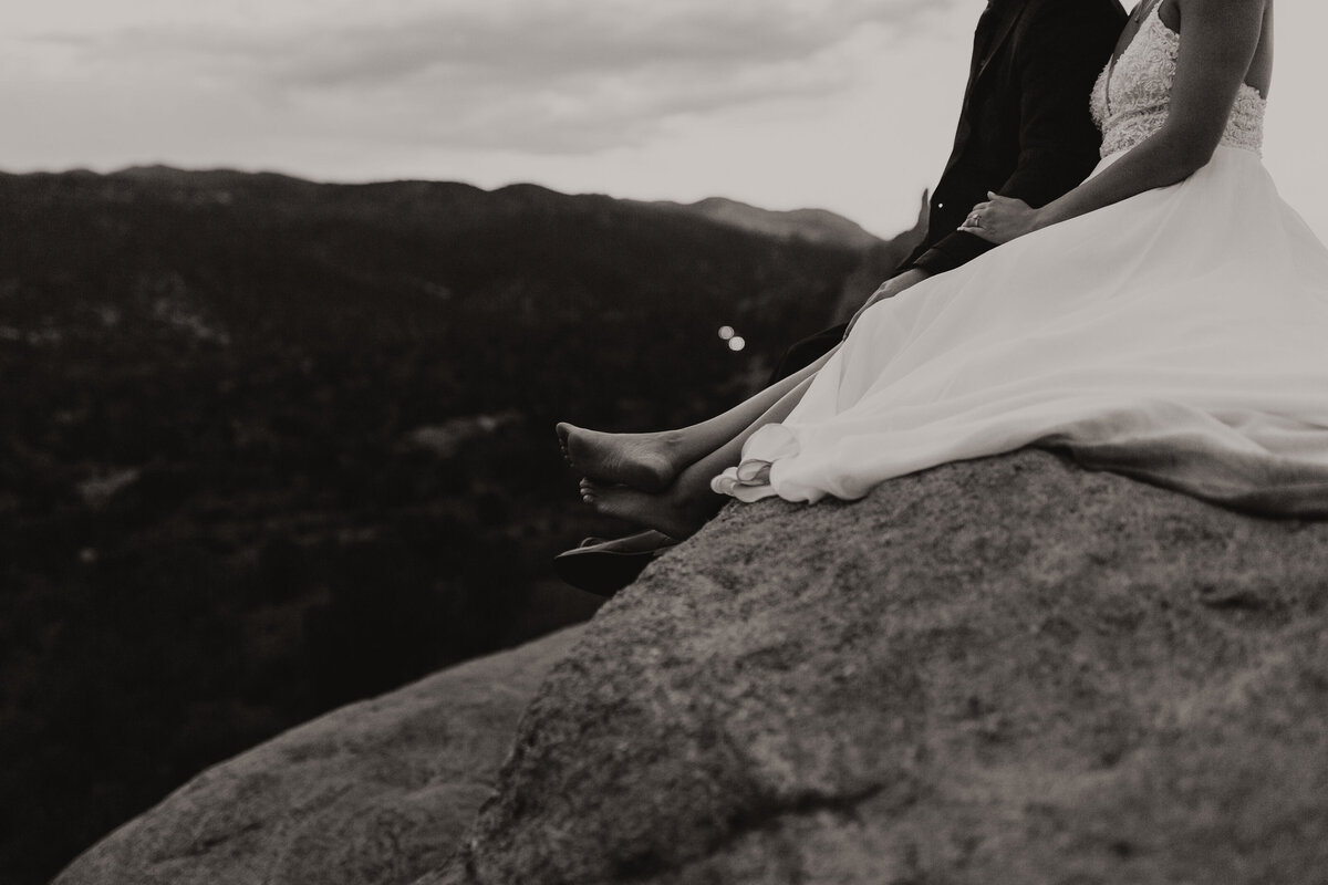 Bride and groom sitting on a rock at the Garden of the Gods