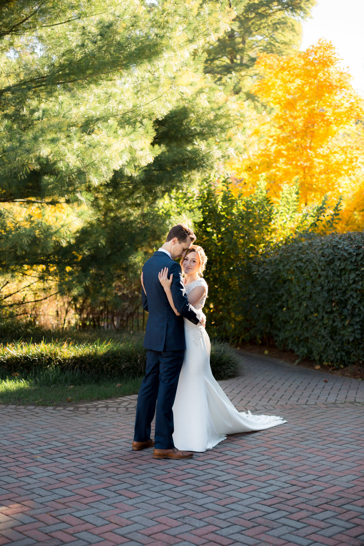 Bride holding groom while being photographed at Agnes Scott College in Atlanta