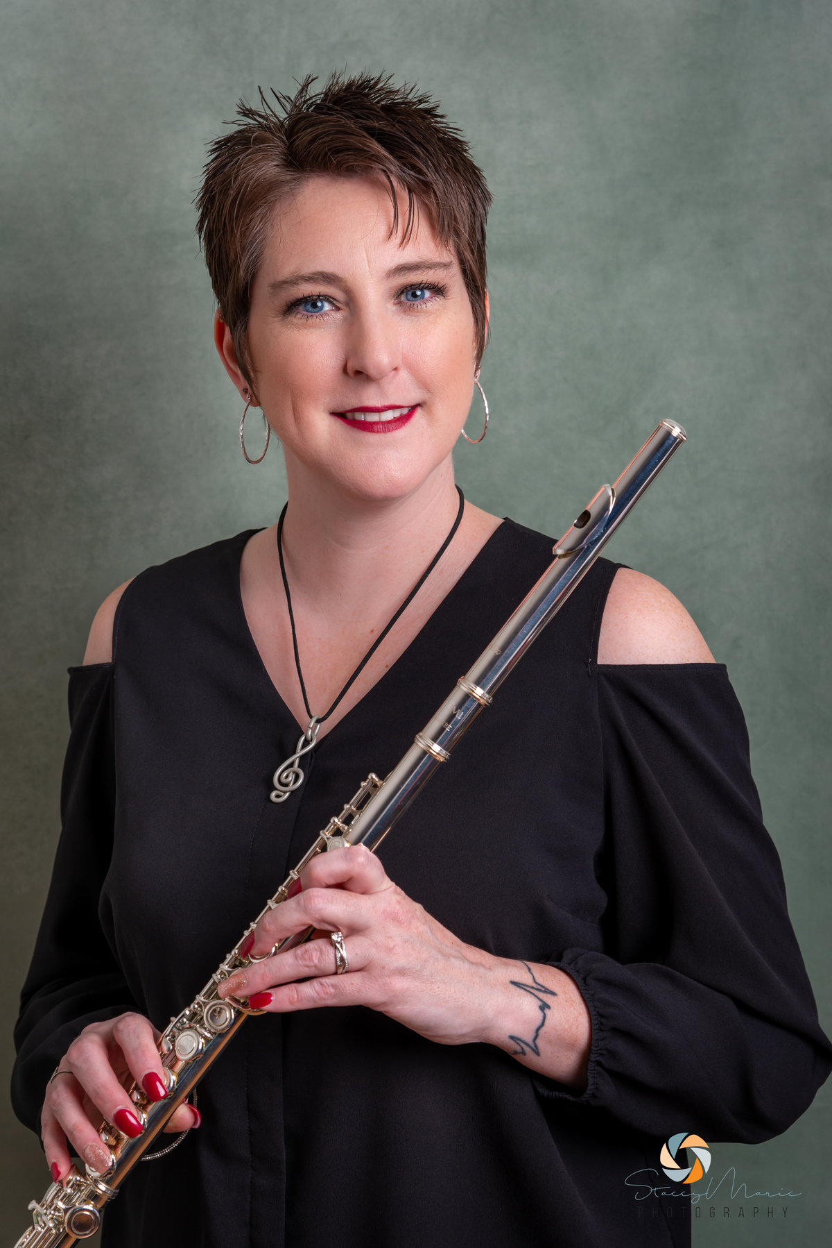 Headshot of a musician holding a flute