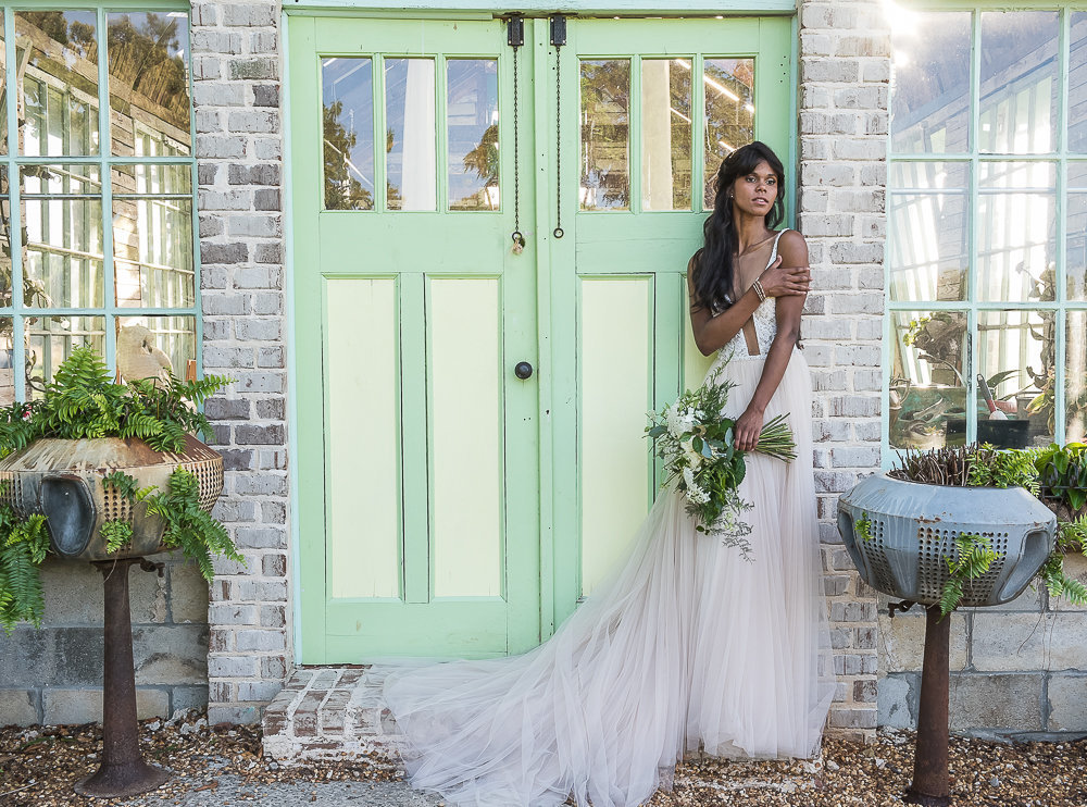 Fashion bride in front of greenhouse
