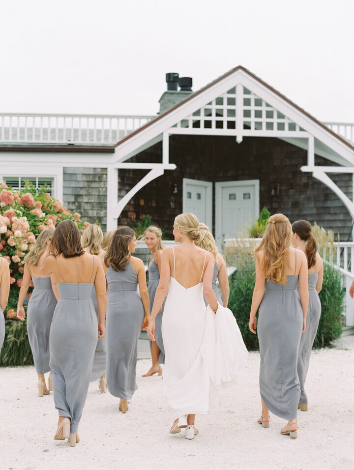 bridal party wearing grey dresses walking at newport castle hill inn